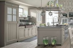 Image from http://img.8-ball.net/2015/07/30/modern-french-country-kitchen-l-9d0c815594050293.jpg.