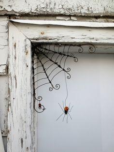 "Delicate Orange Spider Dangles From 12""  Barbed Wire Corner Spider Web. $51.00, via Etsy."