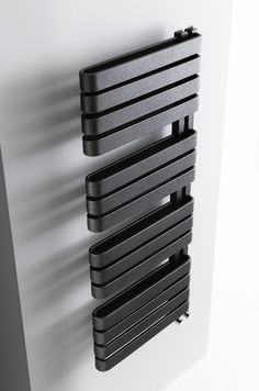 Create a focal point in bathrooms with the iconic design of the Svelte radiator, available in metallic black or soft white - Svelte Towel Warmer from Bauhaus. Bathroom Towel Radiators, Bathroom Towel Rails, Bathroom Wall Cabinets, Bathroom Furniture, Black Towel Rail, Black Towels, Contemporary Bathroom Lighting, Contemporary Bathroom Designs, Towel Warmer