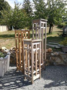 Cedar garden towers create vertical focal points in any garden.