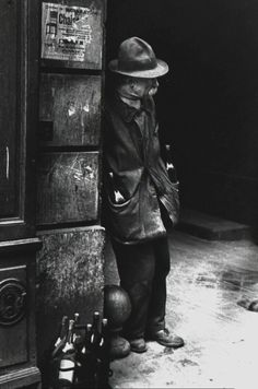 Fred Stein. Untitled (Man with Bottles Paris 1938