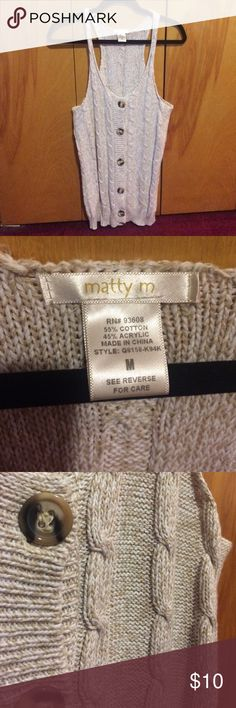 Matty M Sweater Vest White and light beige sweater vest with big buttons down the front as pictured. Size medium and runs true to size. Worn 7-10 times and has a lot of life left. Sweater isn't too heavy. Matty M Sweaters