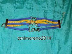 tonimoreno2014: Pulsera azul y amarilla de cuero!!!