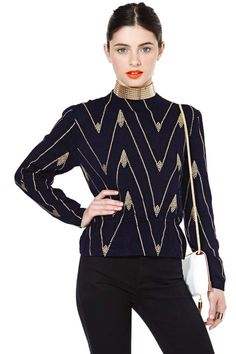 Ah-mazing vintage navy sweater featuring a gold studded print and a fitted waist.