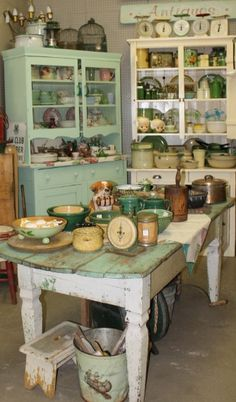Vintage kitchen/ Oh my, I love this soft green, to me it is like jadeite. All of the vintage dishes make me want to go antiquing.