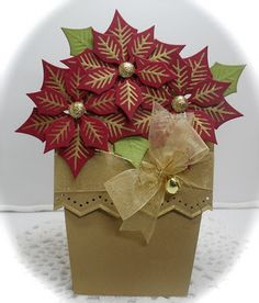 poinsettia card - must remember to try this with the 6 petal flower on my Art Philosophy cricut cartridge.  Beautiful.