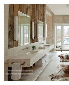 Floating vanities and textured walls make this long narrow bath chic and functional.