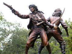 "Anne Bonny and Mary Read were pirates, as renowned for their ruthlessness as for their gender, and during their short careers challenged the sailors' adage that a woman's presence on shipboard invites bad luck.""  Sculpture by Erik Christianson."