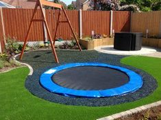 A sunken trampoline is safer for kids and looks really cool! + Recycled shredded tires as mulch for a softer landing.