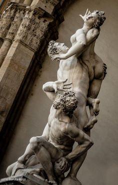 """""""Abduction of the Sabine Women"""" or """"Rape of the Sabine Women"""" -- 1579-83 -- Giovanni da Bologna -- Italian -- Marble -- 13' 5.5"""" in height -- Loggia dei Lanzi, Piazza della Signoria, Florence, Italy."""