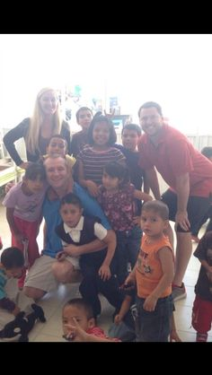 Pile on for a photo in Mexico. These kids love pictures