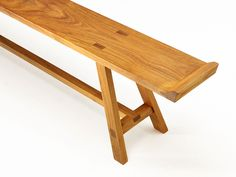 Teak bench from Swiss INCHfurniture.