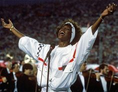 """In her white tracksuit, Houston delivered the hands down most amazing version of """"The Star-Spangled Banner."""" Circa 1991."""