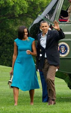 US President Barack Obama and his wife Michelle walk from Marine One to the White House in Washington.