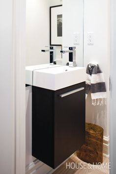 Photo Gallery: Small Bathrooms | House & Home - guest bathroom - wall mounted sink dark cabinetry great faucet