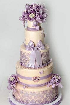 EDITOR'S CHOICE Baroque wedding cake with purple peonies, ribbon and lace stencil by Victorica's Cakes .