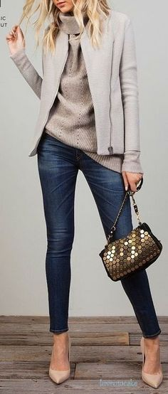Grey zip-closure jacket looks modern. Try it on with knitted turtleneck and…