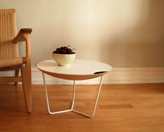 james  James side table is a multi functional furniture. It has a small storage space, and a tabletop which also serves as a tray. It is always at your service, hiding small objects, serving drinks or functions as a small table.