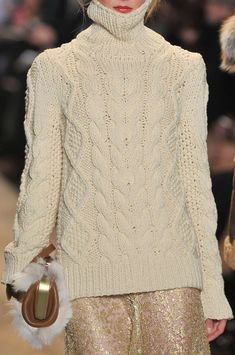 Michael Kors Fall 2012. Beautiful cream, cable-knit turtleneck sweater, with shimmery gold skirt.