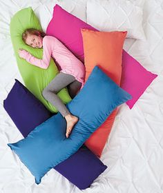 Bright Body Pillow to your space for a pop of color and amazing comfort. Cradle it for extra support while sleeping on your side. Lean back onto it when reading or watching TV. Works as a decorative pillow for your bed as well. Plumped with