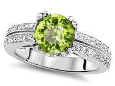Peridot Engagement Wedding Ring - Here's an unusual color but pretty & 100% natural 7mm Round Peridot Engagement Wedding Ring stamped in 925 Sterling Silver within a prong setting. It features a Peridot colored gem set atop of the ring with an additional 44 lovely Round Brilliant Cubic Zirconia accent diamonds that surrounds it. All of the accent diamonds are simulated but not heat-treated. #unusualengagementrings
