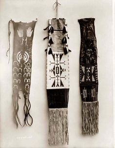 You are viewing an important image of Indian Pipe Bags. It was taken in 1908 by Edward S. Curtis.    The picture shows a nice view of traditional Native American handwork.    We have created this collection of pictures primarily to serve as an easy to access educational tool. Contact curator@old-picture.com.