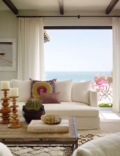 The view, patio furniture, candlesticks, coffee table, and pillows. In that order. : )