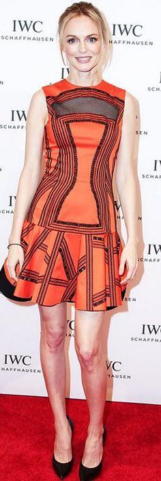 Who made  Heather Graham's orange print dress?