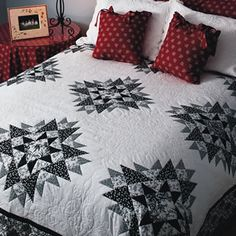 """Cambridge Stars  96½"""" x 96½""""  Quilt Designed by Patti Carey  Made by Susanne Ebsworthy    We love everything about this quilt—the perfect gradations from black to white, the space for great quilting design, and it's large enough for a queen-size bed."""