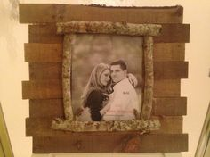 DIY rustic-looking picture frame made from pallets and sticks