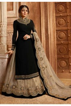 Bollywood diva drashti dhami style black designer lehenga style suit online which is crafted from satin georgette fabric with exclusive embroidery, zari and stone work. This stunning designer lehenga style suit comes with net bottom and net dupatta. Black Lehenga, Lehenga Suit, Lehenga Style, Party Wear Lehenga, Party Wear Dresses, Anarkali Lehenga, Salwar Suits, Party Wear Gowns Online, Gown Dress Online