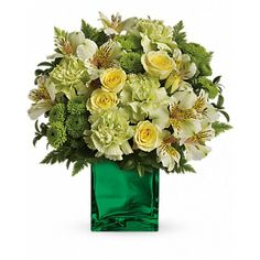 Renew their spirit with this refreshing arrangement of green and yellow blooms in our emerald, mirrored glass cube - a lovely gift for anyone, anytime. Includes yellow roses, alstroemeria, green carnations and button spray chrysanthemums, accented with oregonia and leatherleaf fern. Send #Flowers to LA-California