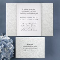 A bright white invitation wrap has your custom verse printed at the center and features a debossed dot and pearl border. The wrap fits around a backer card featuring a shimmery filigree background. Enclosures match the backer card featuring a shimmery filigree background.