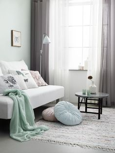 Mint accents in Grey living room