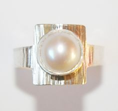 Silver ring.  Hammered textured set with white cultured whole pearl.  Handmade by Reshma Tia Champaneria jewellery.