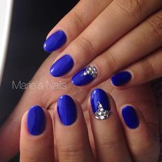 Royal blue embellished nail art