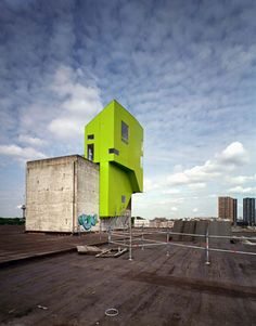 Designed as a prototype house, meant to showcase the combination of prefabrication technologies and 'tailor-made design', the 'Las Palmas Parasite' was constructed on the protruding elevator shaft of the exhibition warehouse – which dictated the size/shape of the plan. The 'object' was constructed on the roof of the existing building, and in true parasitic form it drew all of its services – water, sewage, and electricity – from the warehouse, while also drawing on its support structurally.
