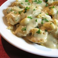 Chicken with 40 cloves of garlic in a creamy sauce.  Tender and juicy meat with garlic that melts in your mouth!!