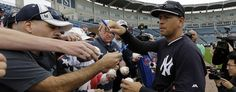 Alex Rodriguez signs autographs for fans during a spring training, Thursday, Feb. 26, 2015, in Tampa, Fla. (Lynne Sladky/AP)