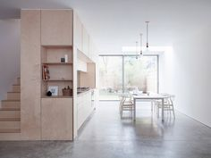 Larissa Johnston minimal London home plywood box - see white metal diving base and white wooden chairs with curved back