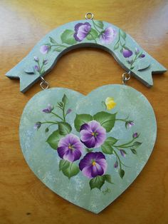 This lady does beautifully hand painted floral items. PANSY WOOD PLAQUE - HEART SHAPED HAND PAINTED PLAQUE WITH PURPLE PANSIES