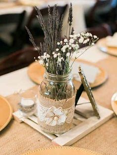 Rustic weddings are all about simplicity. Use small, simple centerpieces like mason jars filled with baby's breath for the perfect rustic touch.
