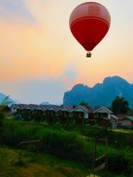 Sunset hot air balloon ride over the mountains in Laos.  www.threeland.com