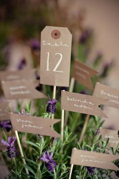 kraft table seating cards - such a cool idea and would look great in herb centerpieces!