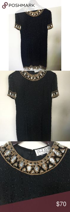 """Vintage A.J. Bari Black Sequence Dress Vintage A.J. Bari Black Sequence Dress sz Petite 8. Gorgeous Vintage Dress great for cocktail or formal party. Collar, cuffs and helm are adorned intricate gold, silver & & black beads and sequences, while the 100 % body has a pattern or long black beads throughout with inside lining. ` Condition: Pre-Owned in good condition.  Measurements:  Pit to Pit: 17""""  Lenght top to bottom: 31""""  Non-Smoking Home A.J. Bari Dresses Midi"""