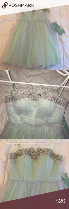 Party dress Iridescent teal, jeweled, party dress! Brand new with tags! Perfect for formal. jcpenney Dresses Mini