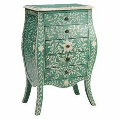 """With a bombe-style silhouette and 5 drawers, this hand-painted green and cream chest offers a touch of organic appeal to your decor. Use it as a console table behind your sofa or to stow table linens in the dining room.   Product: ChestConstruction Material: Engineered wood Color: Green and creamFeatures:  Five drawersHidden storageDimensions: 40"""" H x 26"""" W x 16"""" D"""