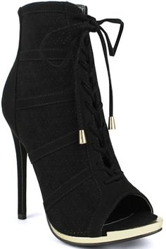 83ef6e19349 These black suede booties feature a front lace design