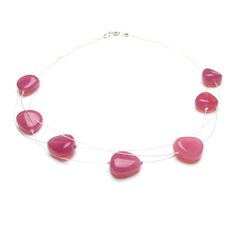 £35: This Nerina necklace has beautiful curving glass nuggets in a beautiful  cool, bright pink colour, perfect for the House of Colour Winter palette.  The beads are hung in a staggered pattern across three strands of silver  tiger-tail thread with a silver coloured clasp.  The necklace is approximately 45cm (18'') long.  'Nerina' means 'Water', which echoes the droplet feel and shape of these  gorgeous beads.