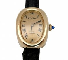 """Concord for Cartier Lady's Yellow Gold Wrist Watch  Lady's Concord for Cartier 18K Yellow Gold """"Baignoir"""" Wrist Watch with Concord mechanical movement.  Gold Exaggerated Roman numeral dial, sapphire winding stem and crystal.   Original black leather Cartier Strap.   One year guarantee on the movement.  Item Number: WOO608"""